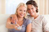 Close up of a cute couple watching TV — Stock Photo