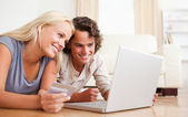 Close up of couple purchasing online — Stock Photo