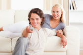 Lovely couple watching the television — Stock Photo