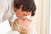 Close up of a man kissing his fiance on the forehead — Stock Photo