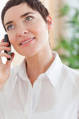 Close up of a good-looking woman with a cellphone — Stock Photo