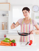 Beautiful woman cooking — Stock Photo