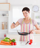 Smiling woman cooking — Stock Photo