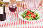 Charming Woman eating lunch and drinking wine — Stock Photo