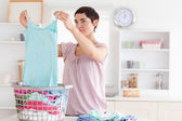 Woman folding clothes — Stock Photo