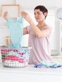 Cute Woman folding clothes — Stock Photo