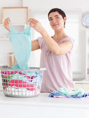 Charming Woman folding clothes — Stock Photo