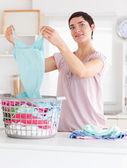 Charming Woman folding clothes — Stock Photo