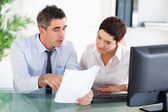 Office workers looking at a document — Stock Photo