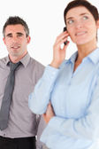 Portrait of a woman on the phone call while her coworker is posi — Stock Photo