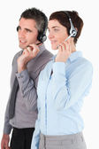 Portrait of operators using headsets — Stock Photo