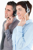 Portrait of operators with headsets — Stock Photo