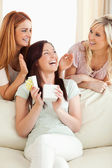 Cheerful Girls giving their friend a present — Stock Photo