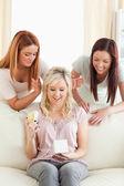 Gorgeous women giving their friend a present — Stock Photo