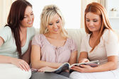 Charming Women reading a magazine — Stock Photo
