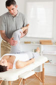 Chiropractor and patient doing exercises — Photo