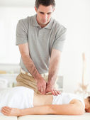 Gorgeous woman getting a back-massage — Stock Photo