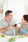 Happy couple toasting with redwine — Stock Photo