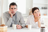 Tired couple drinking coffee — Stock Photo