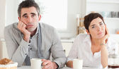 Worn out couple drinking coffee — Stock Photo