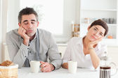 Bored couple drinking coffee — Stock Photo