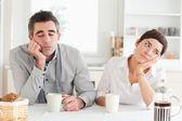 Unhappy couple drinking coffee — Stock Photo