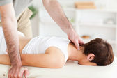 Young woman being massaged — Stock Photo