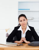 Confident businesswoman sitting in her office — Stock Photo