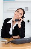 Cheerful cute businesswoman telephoning — Stock Photo