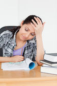 Student looking to her homework — Stock Photo