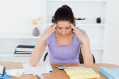 Stressed young woman accounting — Stock Photo