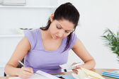 Bored young woman accounting — Stock Photo