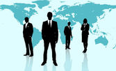 Businesspeople standing against a blue world map — Stock Photo
