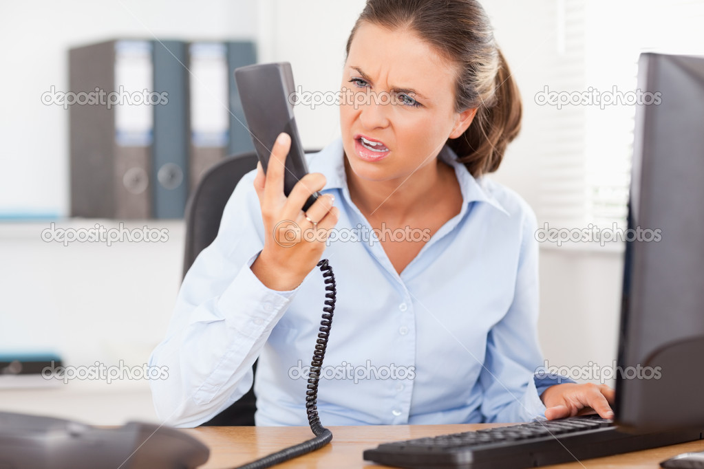 A businesswoman gets upset in a conversation — Stock Photo #11181480