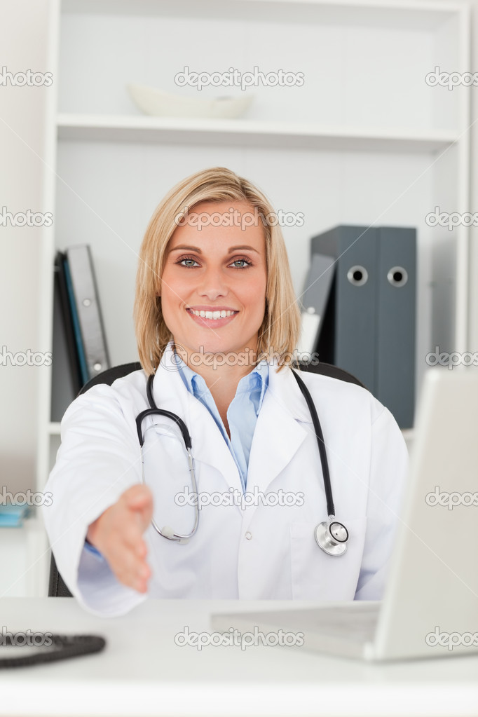 Smiling doctor giving hand in her office  Stock Photo #11182050