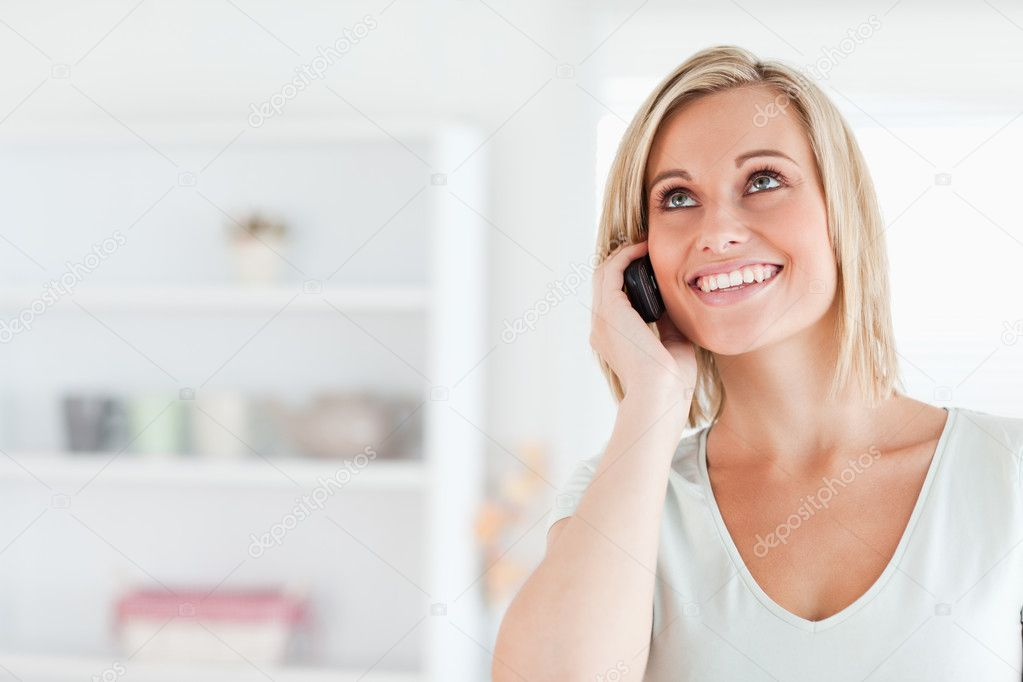 Woman on the phone in the kitchen — Stock Photo #11182206