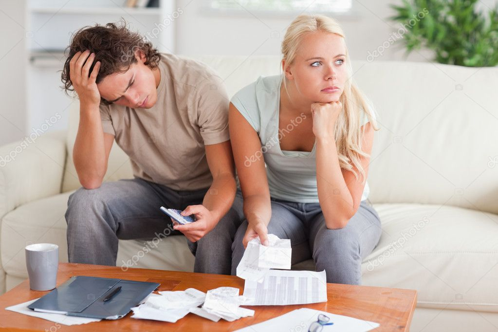 Couple figuring out what to do sitting in the livingroom — Stock Photo #11184821