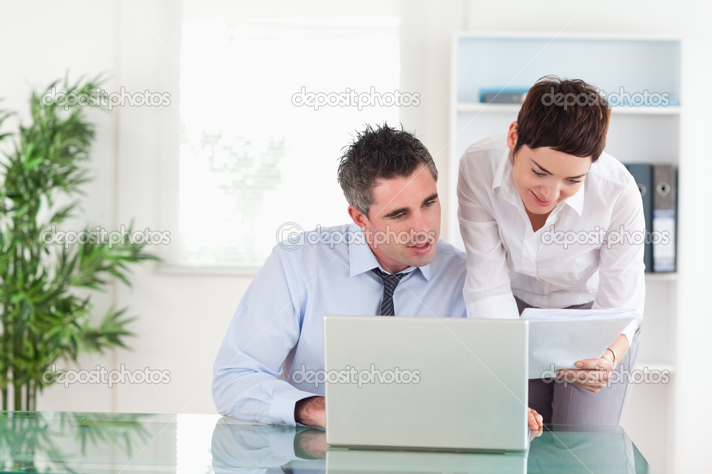 Colleagues comparing a blueprint document to an electronic one in an office  Stock Photo #11188185