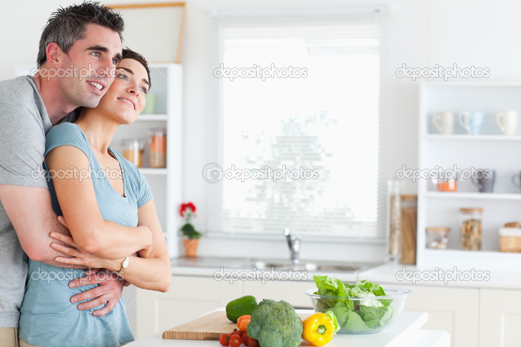Man and woman hugging in a kitchen  Stock Photo #11189354