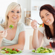 Cheerful young Women eating salad — Stock Photo