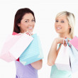 Cheerful women with shopping bags — Stock Photo