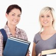 Close up of College students holding books — Stock Photo