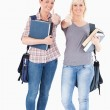 Portrait of smiling College students holding books — Stock Photo
