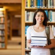 Student holding books — Stock Photo