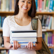 Portrait of a student holding books — Stock Photo