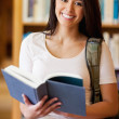 Portrait of a cute student holding a book — Stock Photo #11190573