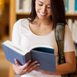 Portrait of a cute student reading a book — Stock Photo #11190574