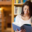 Cute student reading a book — Stock Photo #11190575