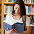 Portrait of a beautiful student reading a book — Stock Photo #11190576