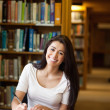 Royalty-Free Stock Photo: Portrait of a smiling student writing a paper